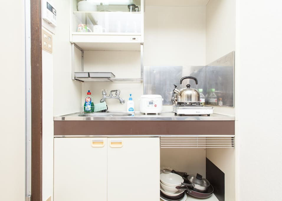 Small Kitchen Unit with basic cooking supplies.
