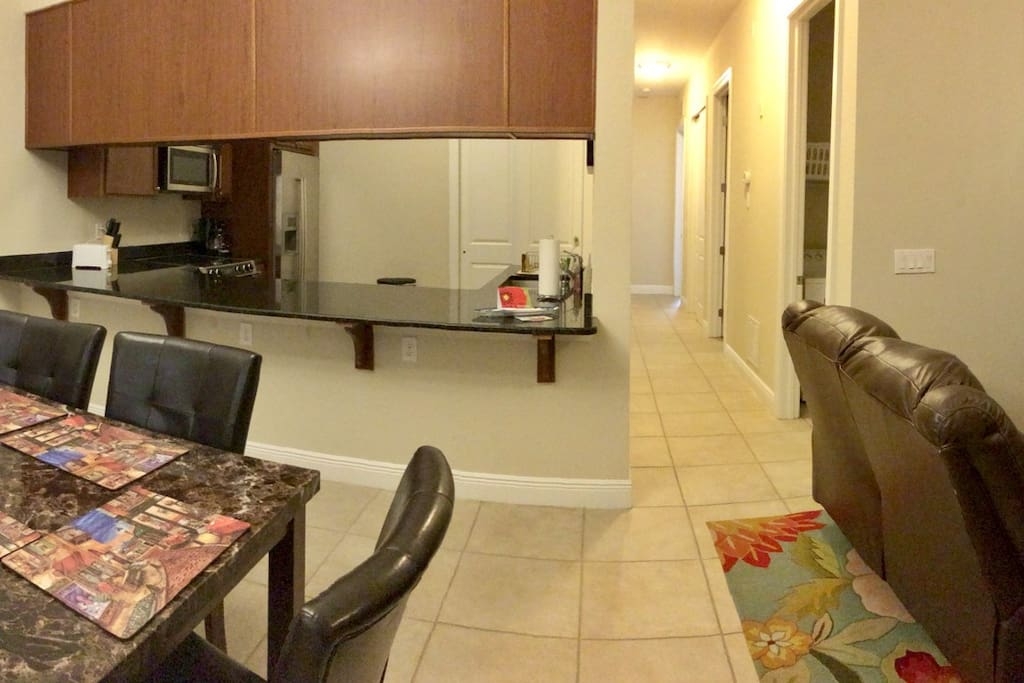 Living and Dining area open floor plan. Free WiFi and basic cable TV.