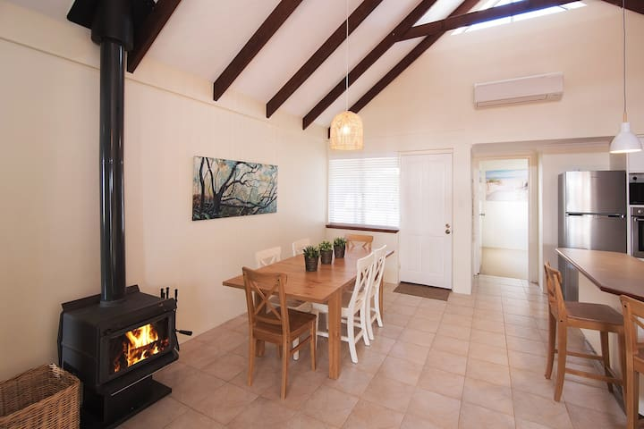 Warm up in winter with the wood fire.  The Villa also has reverse cycle heating/air conditioning.