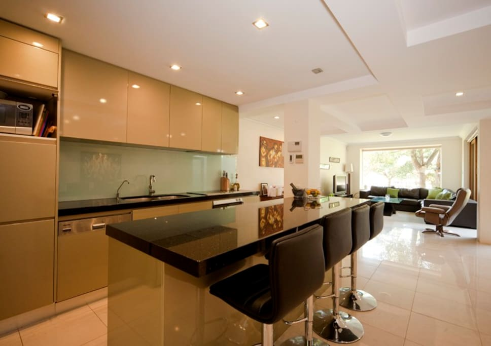 modern open plan kitchen, brekky bar, dining and living room