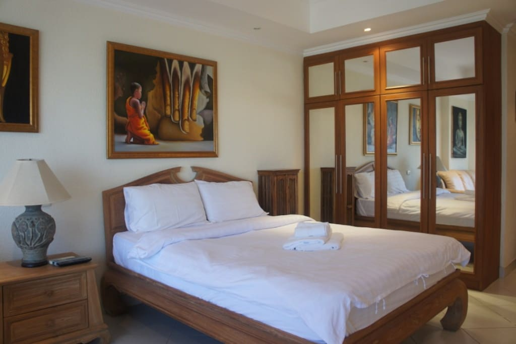 A beautifully crafted Thai Teak bed, with Teak wood fitted wardrobes.