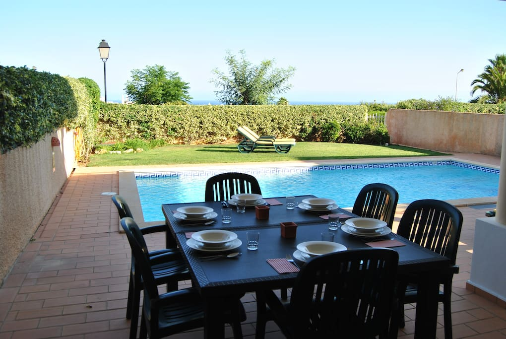 Spacious patio with an amazing sea view. Private garden and swimming pool