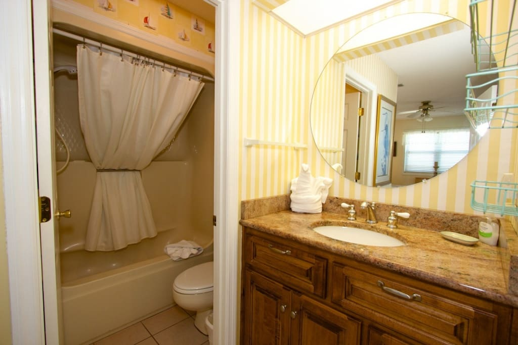 Master bath has tub, shower and toilet in separate space.