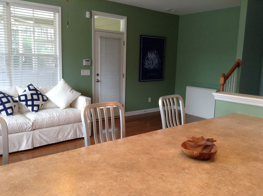 Kitchen and family room.  White console in corner unfolds to dining table that fits six.