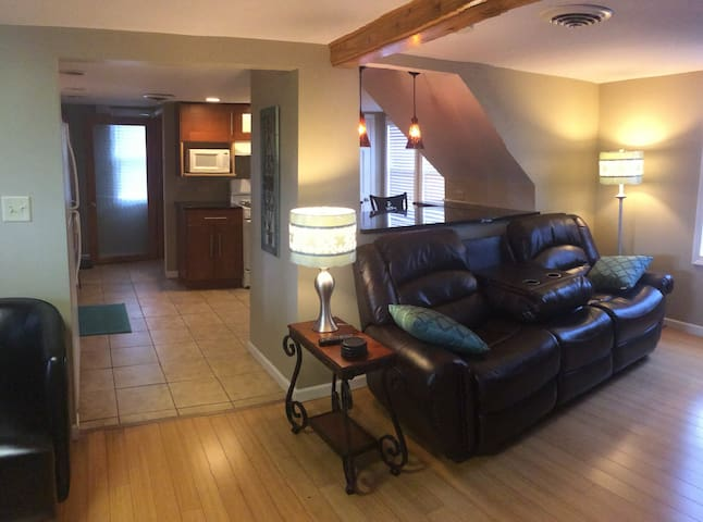 Comfortable living room with wood floors, recliner couch