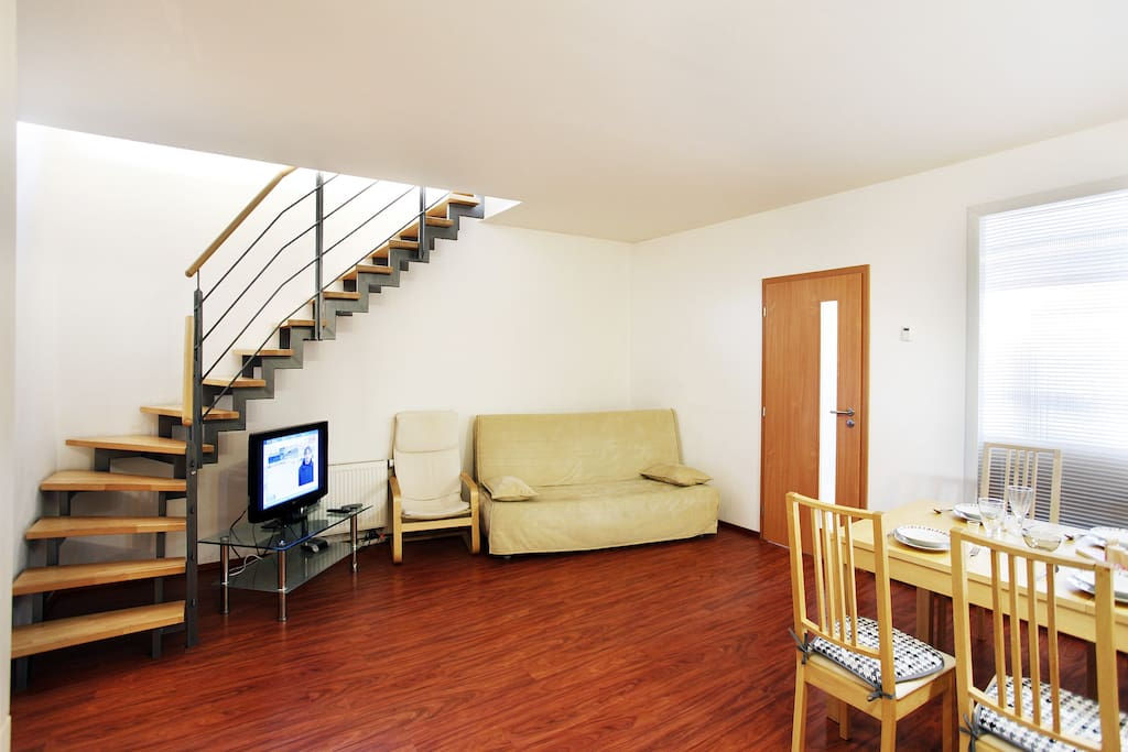 hall on the first floor with comfortable pull out sofa and TV with satellite