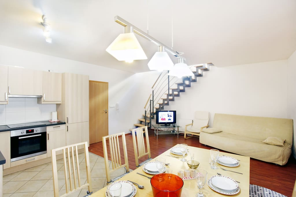 spacious living room with kitchen area