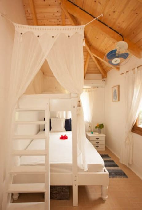 Guest Bedroom - Comprised of single bunk bed above double bed