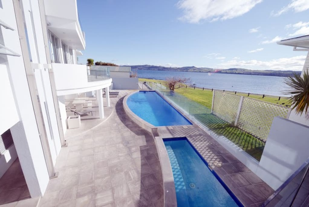 Enjoy the heated pools overlooking the lake