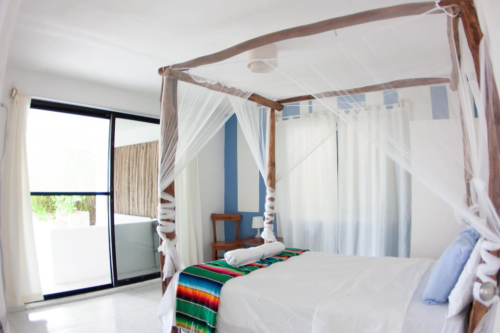 Bedroom 1 (1 double bed, patio doors and view of the beach)