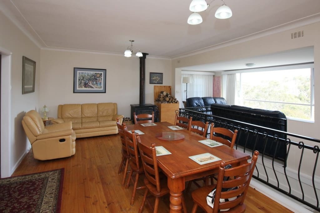 Large dining and sitting area with wood heater.