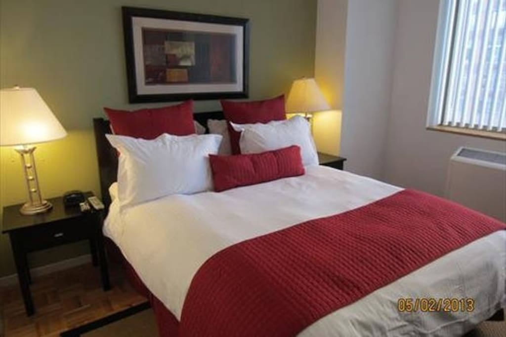 The private bedroom features a queen size bed and a walk in closet.