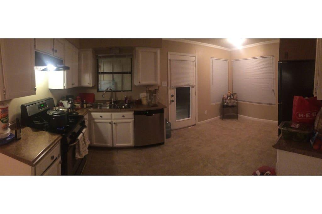 Roomy Kitchen with Dishwasher, Gas Stove, Fridge, and Juicer