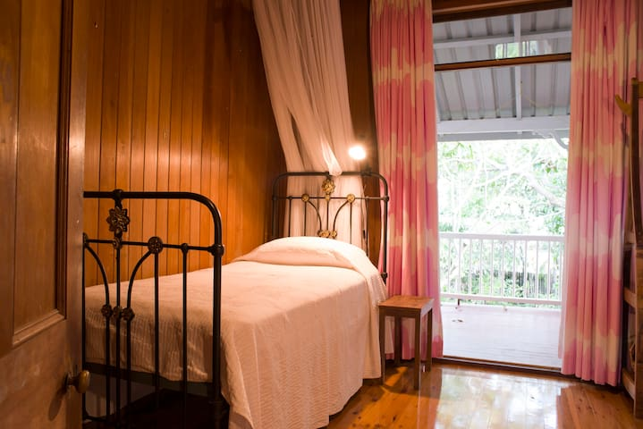 Antique caste iron beds make for comfortable old-fashioned sleeping arrangements in the twin room