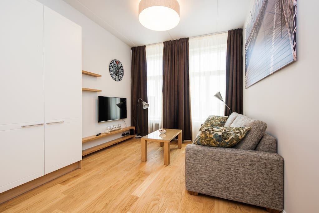 Relax in your own cozy living room with a large TV and Wifi after a busy day in Tallinn