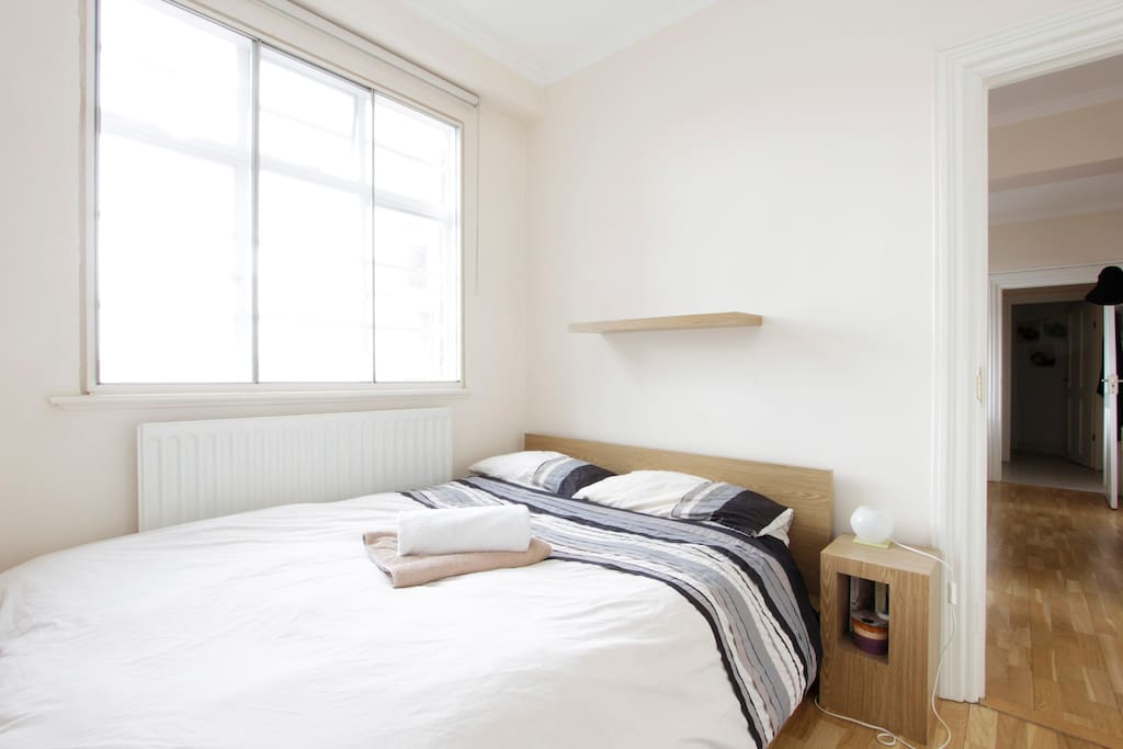 Bright bedroom, double bed