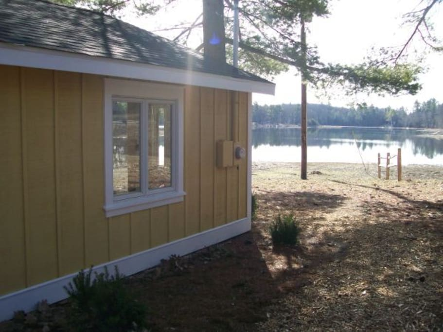 This is the front of the cottage. The living room looks out over the lake.