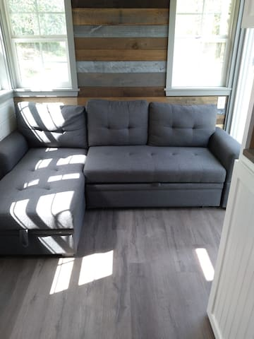 Living room area - this couch pulls out to a double bed