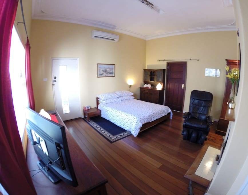 Comfortable large bedroom with original jarrah floorboards. Airconditioning, TV, DVD, MP3, Reading lamps and Massage Chair.