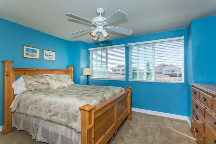 Upstairs Guest Bedroom with Peak Ocean View, Ceiling Fan and Attached Bathroom
