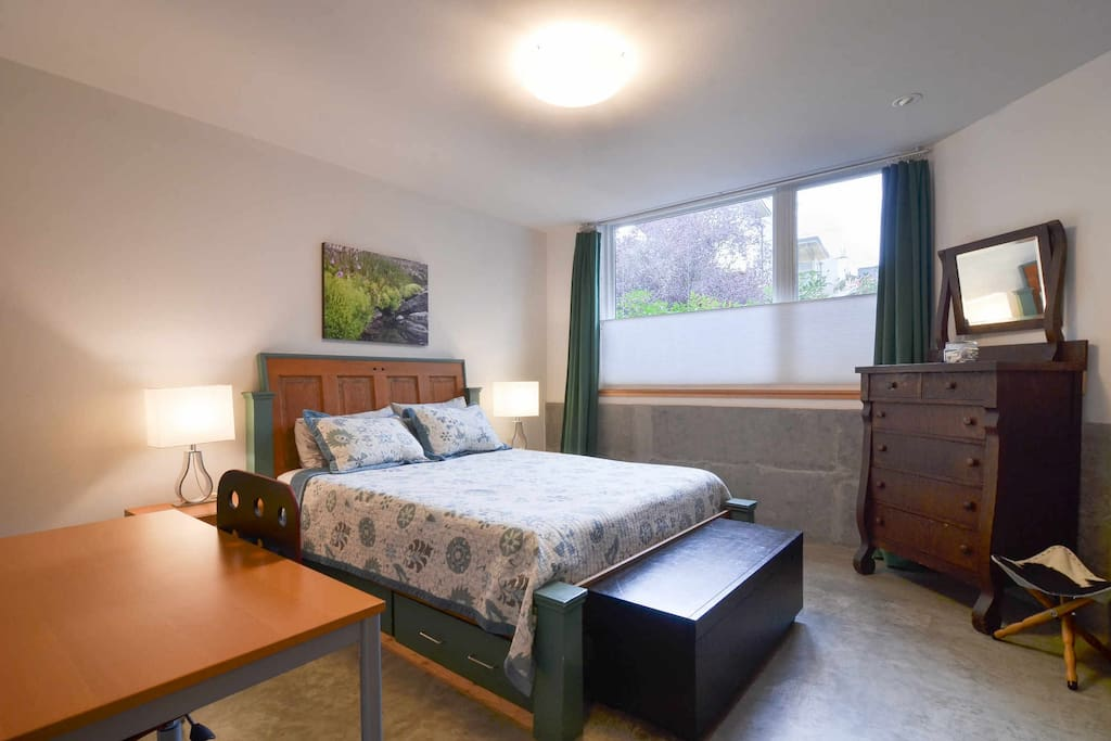 The Plum Apartment has a spacious bedroom with a large closet, tons of natural light and a work space.