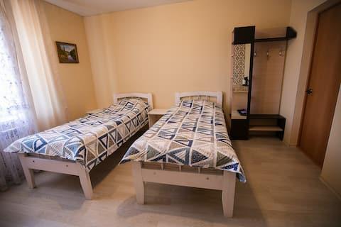 Двухместная комната в доме с 2 отдельными кроватями
