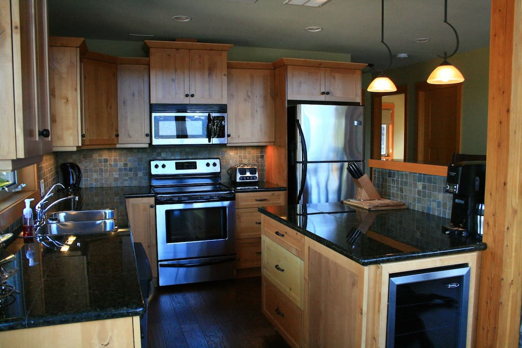 Fully equipped kitchen with wine fridge.