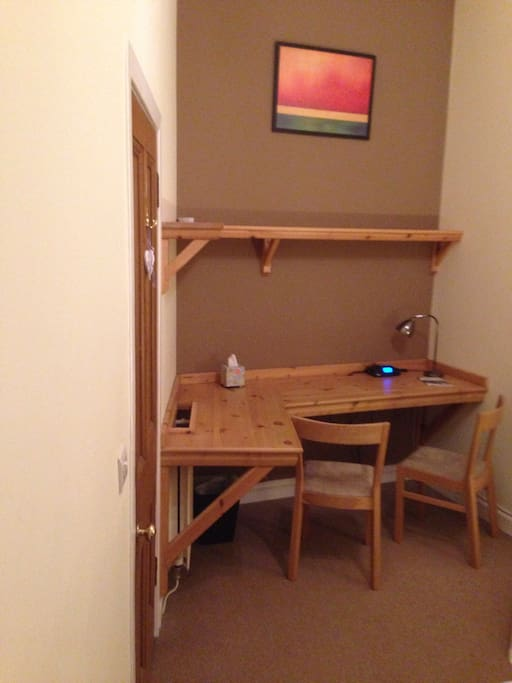 Bespoke desk/shelf space with chairs for 2, alarm radio, hairdryer, kettle with tea/coffee and desk light.