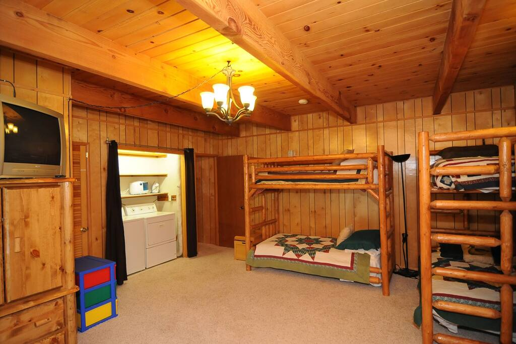 Cool Kids Room with 2 sets of Log Bunk Beds and Washer and Dryer.