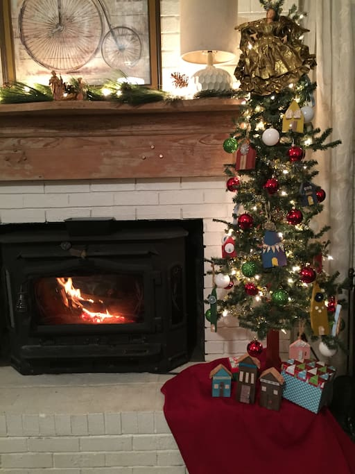 Warm fire with the tree decked out in handmade ornaments