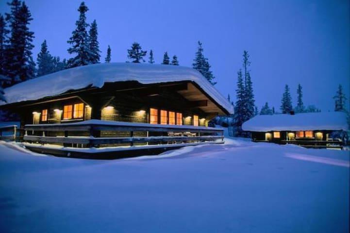 Wooden ski cabin in large Swedish ski resort