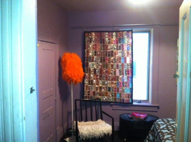 bedroom with big closet and dresser
