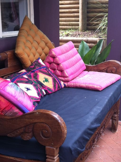 Relax on our old teak Balinese daybed