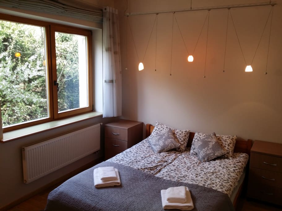 Standard double room bed and window
