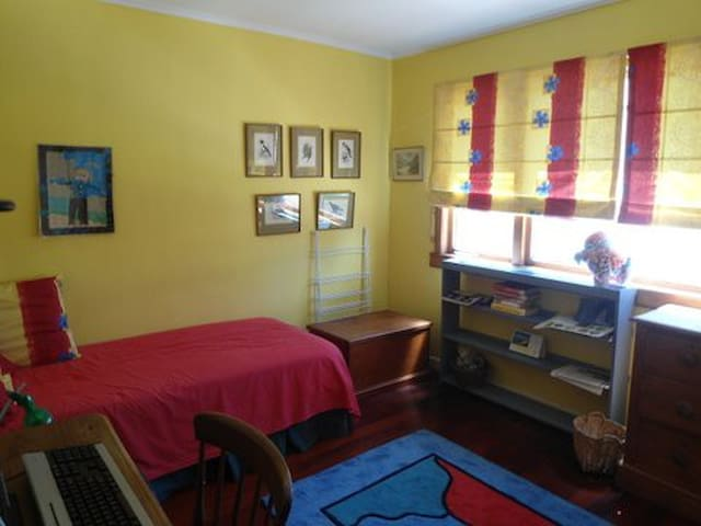 This is your room doesn't show the other bed and small desk. Full of morning sunshine
