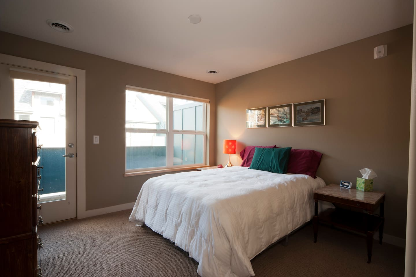 Your room, with private balcony. (Door and windows both have blinds)