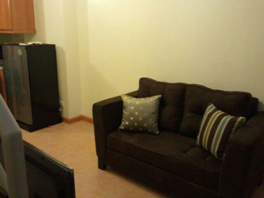 Clean uncluttered living room with lcd cable tv and wifi