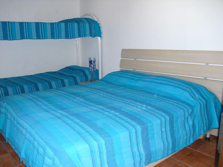 Camera da letto con 4 posti letto