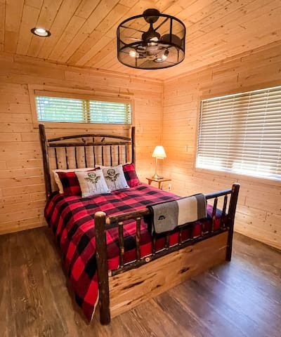 The second bedroom has this wicked cool queen bed, even cooler ceiling fan, and features a wall-mounted tv.