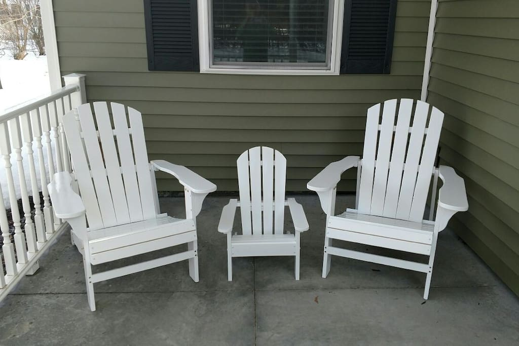 Front porch with Adirondack chairs.
