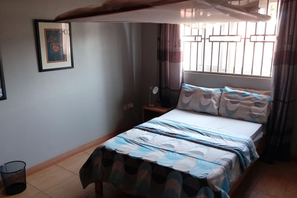 Tidy room with double bed and full of light