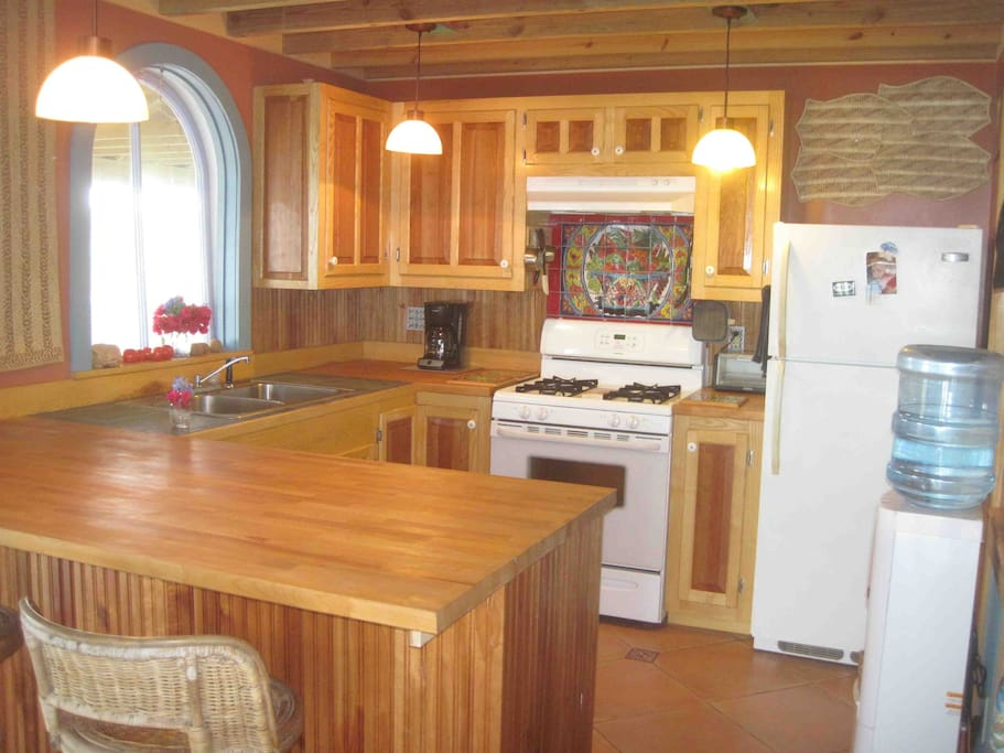 the full kitchen with custom hardwood cabinets that goes with the 2 or 3 bedroom rental
