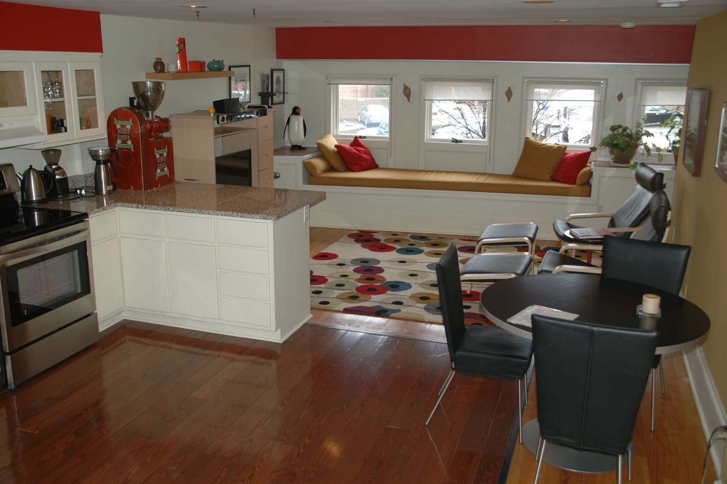 Spacious eating and living area with window seat overlooking Durham's Five-Points.