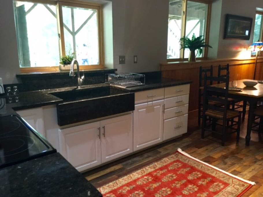 Kitchen has gorgeous granite counters and a custom farmhouse sink, and has everything you need to create gourmet meals in house.