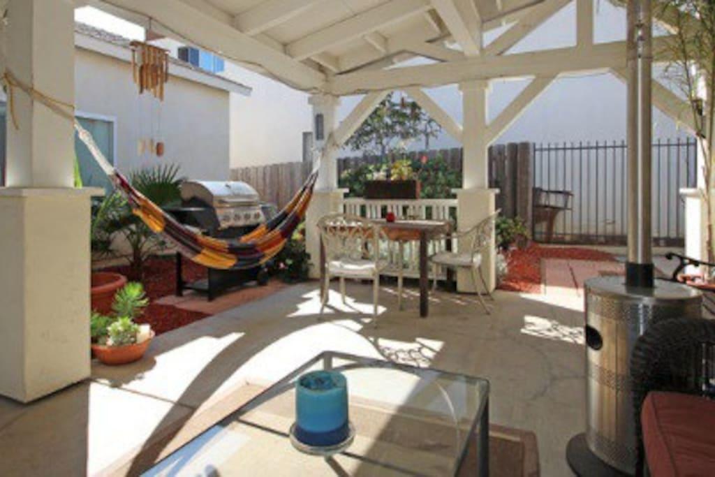 Outdoor patio of relaxing in our hammock, BBQ & outdoor heater