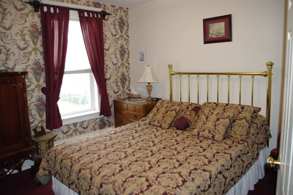 queen bed in room with private deck