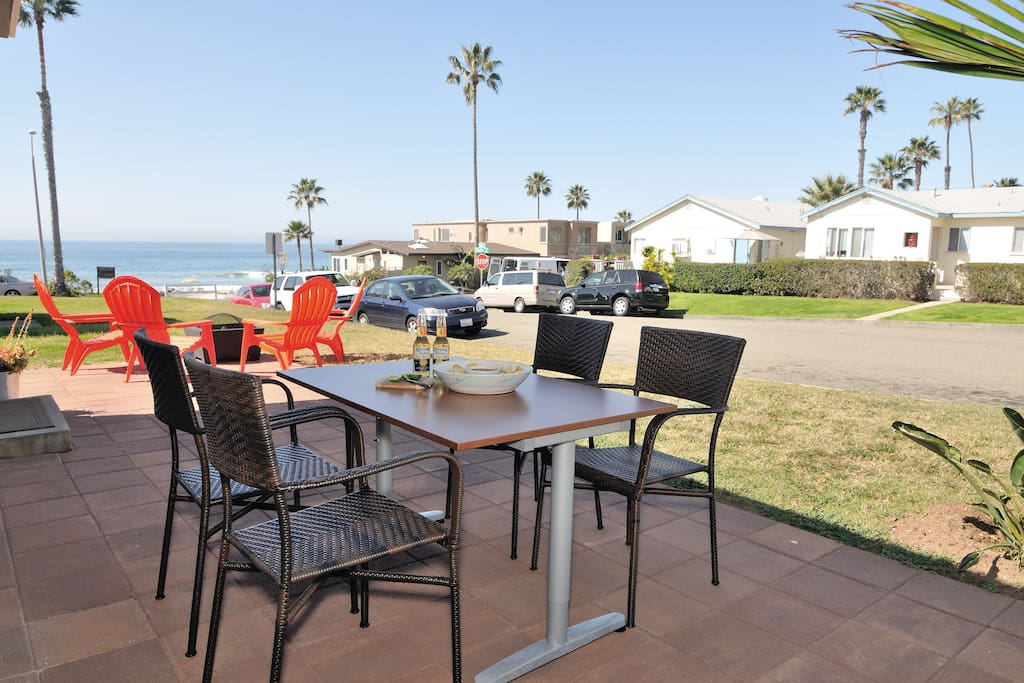 Outdoor eating across the street from a sandy unrestricted beach