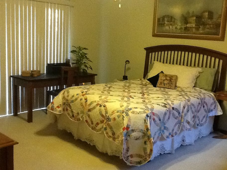 Tempurpedic queen bed & writing table.
