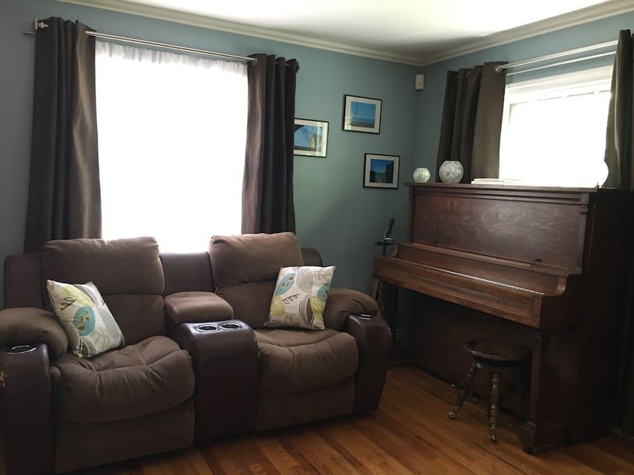 Living room w/fireplace, recliner sofas & HDTV