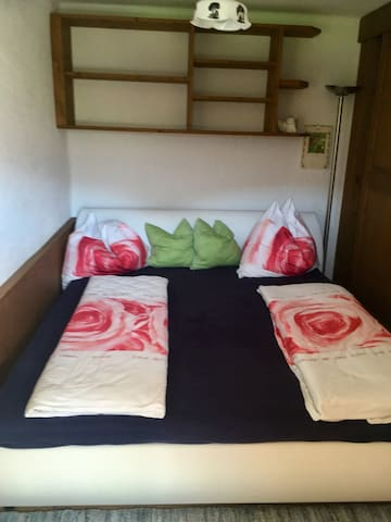 Schlafzimmer. Sleeping room with comfortable bed for 2 guys.
